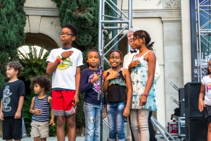 Children lead the Pledge of Allegiance